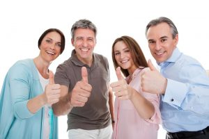Group Of Happy People Showing Thumb Up Sign Over White Background